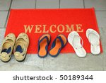 Pairs Of Foot-wares At The Door Step - stock photo