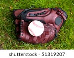 Baseball glove and ball - stock photo