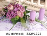 Violet wedding decoration with flowers and candles - stock photo