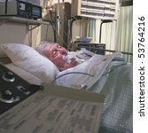 elderly man in hospital bed - stock photo