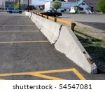 Concrete Barrier between parking lots - stock photo