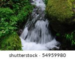 Closeup of a clear mountain spring - stock photo
