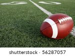 American Football with the Fifty Yard Line Beyond - stock photo