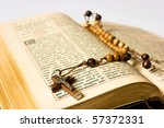 The book of Catholic Church liturgy and rosary beads - stock photo