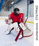 Ice hockey goalie. Picture taken on ice rink. - stock photo