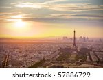 Paris skyline at sunset with Eiffel tower on the right - stock photo