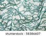 Green wrinkled lace on white spandex background, macro view - stock photo