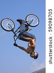 MILFORD, CT - AUG 16: Hector Restrepo performs high-flying BMX stunts at a performance by Eastern Action Sports Teams in Milford, CT, on August 16, 2009. - stock photo