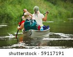 People boating on river - stock photo