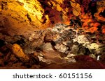 A cave with the illuminated stony walls - stock photo