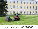 A lawn-mower at work - stock photo