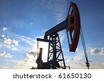 A field pump under the sky - stock photo