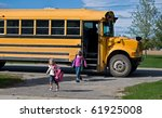 children getting off school bus - stock photo