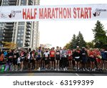 TORONTO-OCTOBER 17: Starting from Mel Lastman Square, the runners traveled through the streets of the city as they made their way to the finish line at Queen's Park, on October 17, 2010 in Toronto. - stock photo