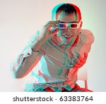 young man, looking through stereo glasses (anaglyph effect. need stereo glasses to view in 3D) - stock photo