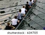 Rowing team on water - stock photo