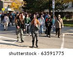 OTTAWA, CANADA - OCT 23:  Unidentified people dressed as zombies walk through Ottawa for the annual Zombie Walk, October 23, 2010 in Ottawa, Ontario. - stock photo