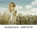 Portrait of beautiful girl in field - stock photo
