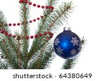 blue ball hangs on christmas tree with red garland isolated on white - stock photo