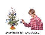 boy hangs the last ornament on his christmas tree isolated on white - stock photo