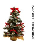 Small decorated Christmas tree with bells - stock photo