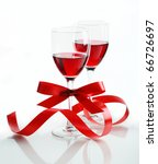 Glass of red wine on a white background and with soft shadow - stock photo