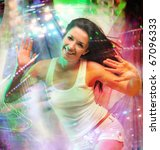 Young woman dancing at night club and looking at camera with smile - stock photo