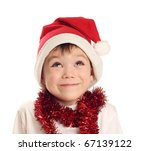 Little boy with Santa Claus hat isolated on white background - stock photo