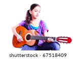 Young girl playing a guitar isolated on white - stock photo