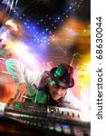Disc jockey work with electronic mixer and mixing records at night club - stock photo