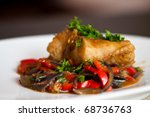 Cod fillet with vegetables - stock photo