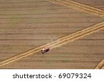 Aerial View : combine harvester working in the fields - stock photo