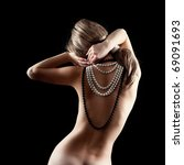 Naked beautiful woman wearing pearls around her neck, back view - stock photo