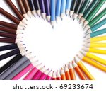 White heart surrounded with color pencil - stock photo