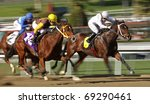 ARCADIA, CA - JAN. 15: Female jockeys Joy Scott (white cap) and Nicole Shinton (gold cap) battle for the lead in a claiming race at Santa Anita Park on Jan. 15, 2011 in Arcadia, CA. - stock photo
