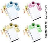 Set of colorful knitted baby booties with notepad and pen. notebook on a spring - stock photo