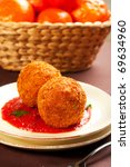 Deep fried balls of arborio rice stuffed with mozzarella cheese - stock photo
