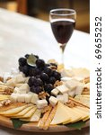 cheese plate with grape and red wine - stock photo