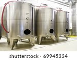 Row with industrial wine cistern - stock photo