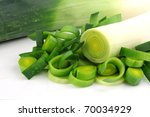 fresh cut leek on a white background - stock photo