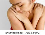 Asian ethnic young female with allergic skin rash - stock photo