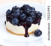 Cheesecake with fresh blueberries on white plate closeup - stock photo