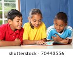 Learning together three happy young school kids - stock photo