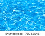 Beautiful splashes of fresh water on a color background - stock photo