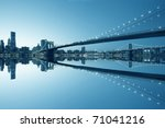 New York City Manhattan skyline and Brooklyn Bridge at dusk with reflection - stock photo
