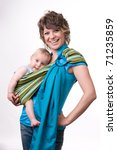 Beautiful young mother carrying her baby in a sling - stock photo