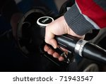 caucasian man refueling a car with diesel - stock photo