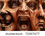 Close-up image of a Venetian mask representing three face expressions. - stock photo