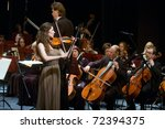 "DNEPROPETROVSK, UKRAINE - FEBRUARY 28: ""Violin Concerto"" by Peter Tchaikovsky performed by Maria Shamshina and Academic Symphony Orchestra on February 28, 2011 in Dnepropetrovsk, Ukraine - stock photo"