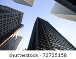 Look to the sky surrounded by skyscrapers of Manhattan - stock photo